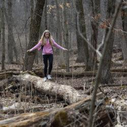 A girl walking on a log
