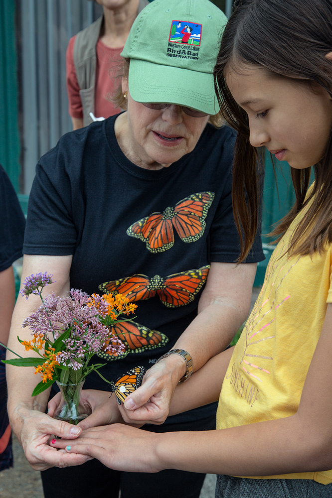 Shelly Culea (left) demonstrates tagging to a young citizen scientist