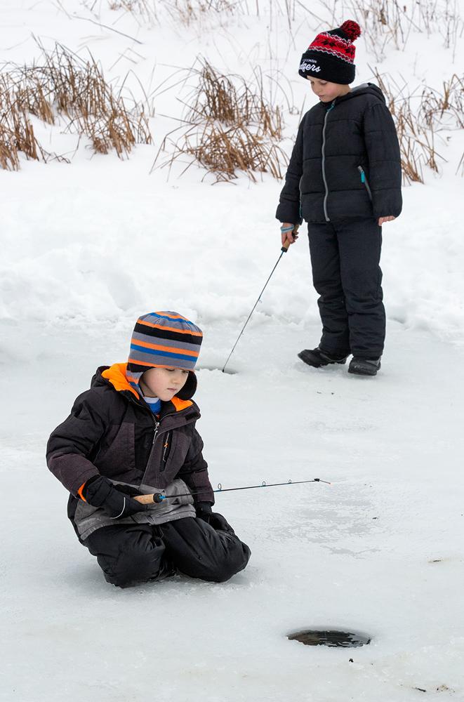 two boys ice fishing