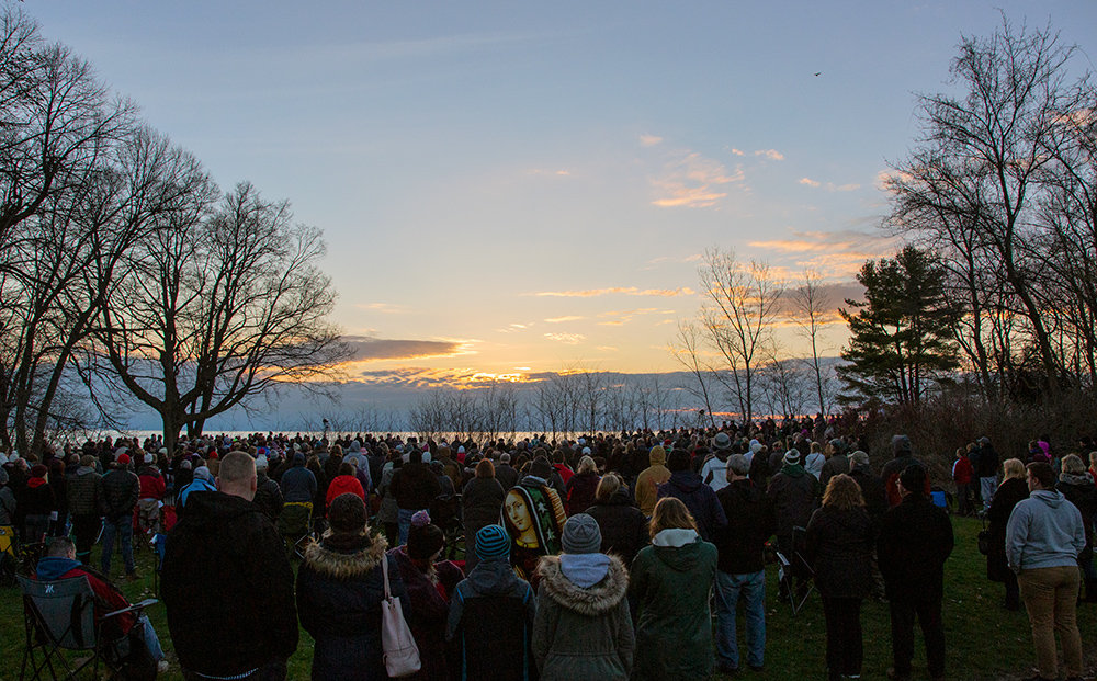Hundreds of people gathered on bluff overlooking Lake Michigan