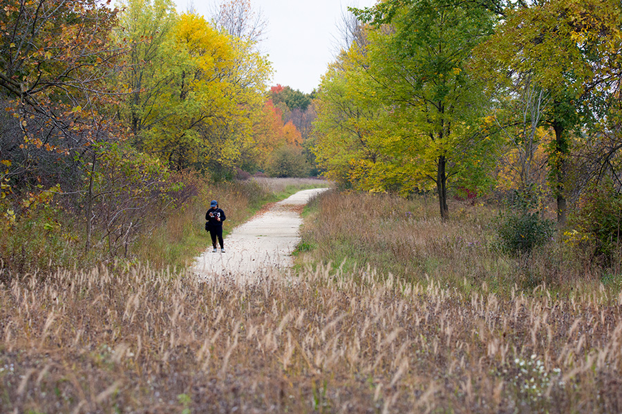 hiker with cellphone in autumn