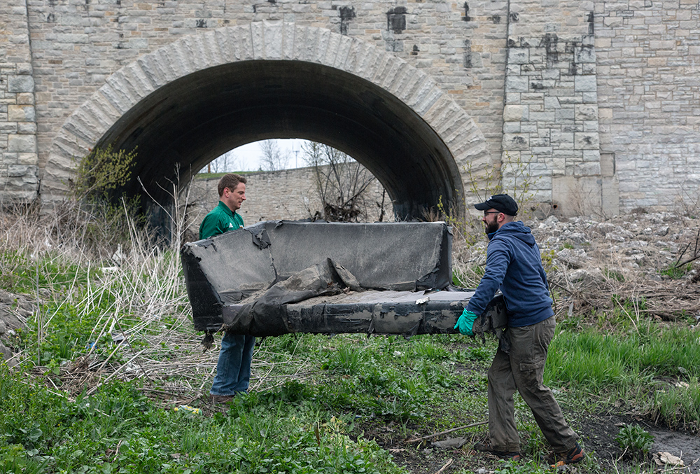 lifting a couch at Lincoln Creek
