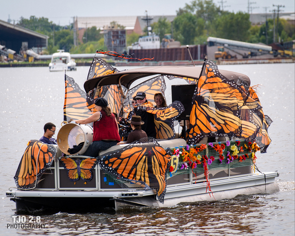 boat decorated with monarch butterflies