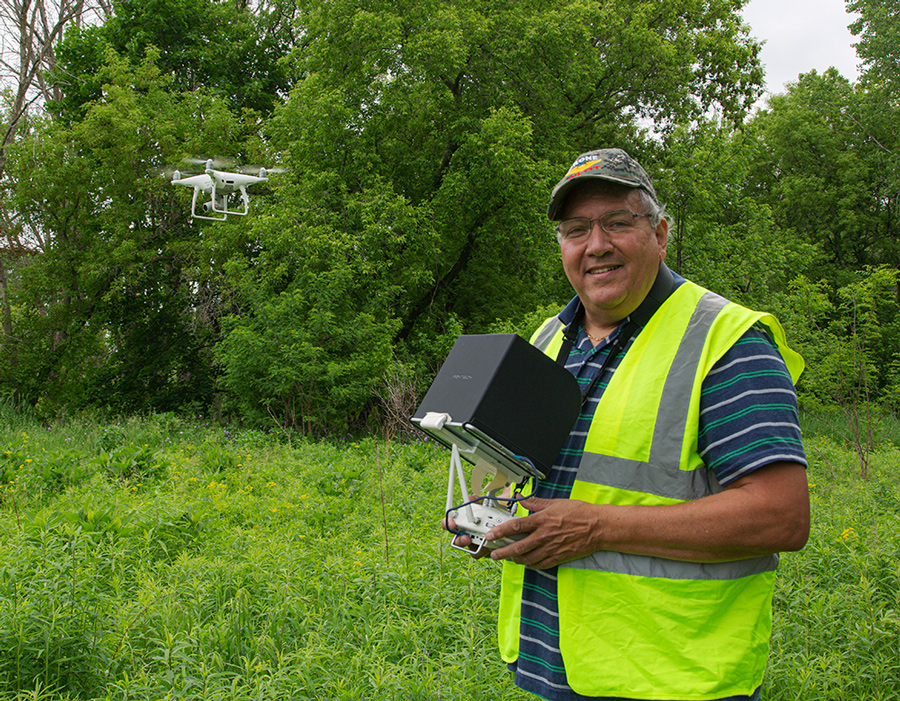 Drone operator Phil Morales with one of his drones in flight