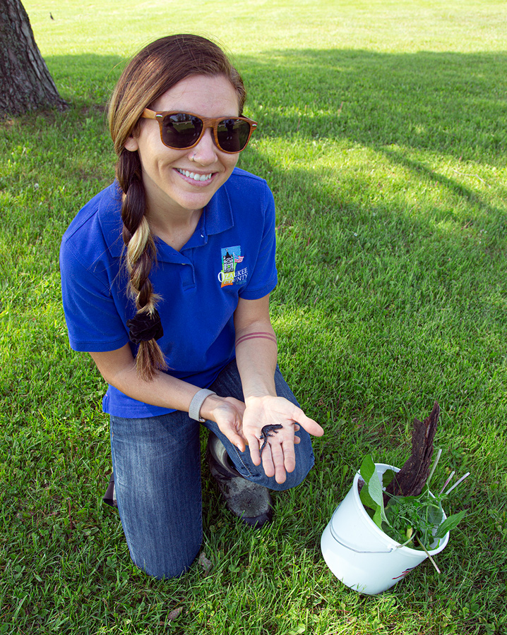 Ozaukee County Parks employee holding a salamander at Virmond Park
