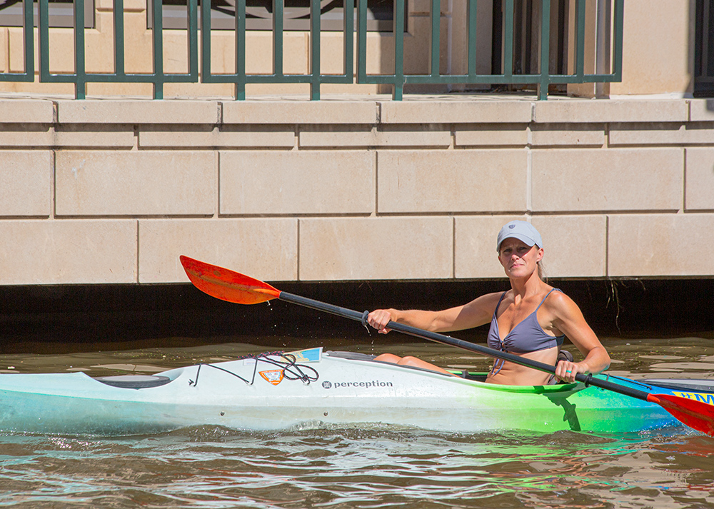 a female kayaker paddling
