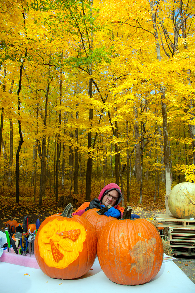 man carving pumpkins at Milwaukee County Zoo
