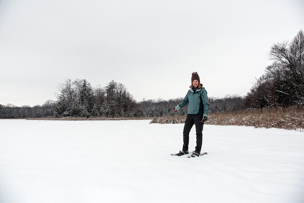 a woman snowshoeing on a frozen lake