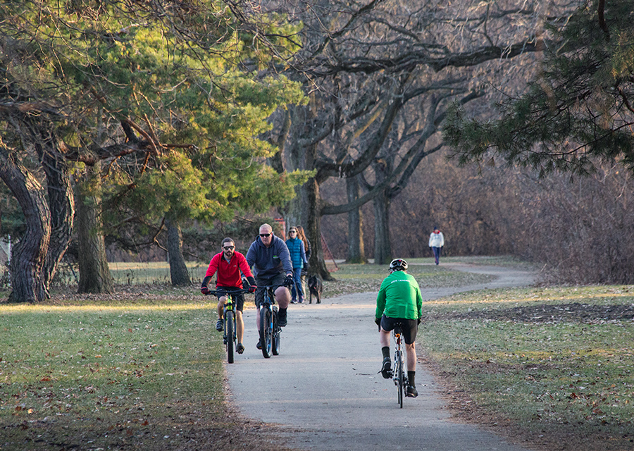 Several people walking and riding bicycles on the Oak Leaf Trail