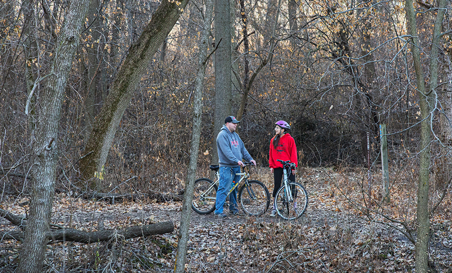 two cyclists on a woodland trail