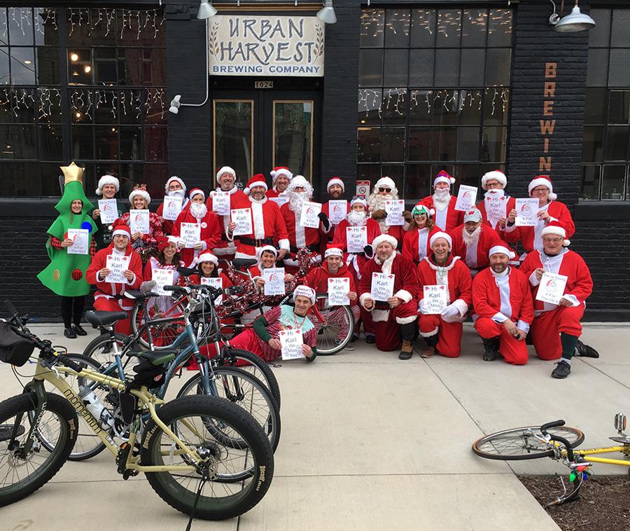 """group photo of """"santas"""" at Urban Harvest Brewing Company just before the Santa Rampage began"""