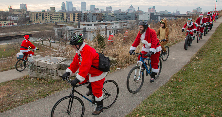 Santa Rampage cyclists in Kadish Park with Milwaukee skyline