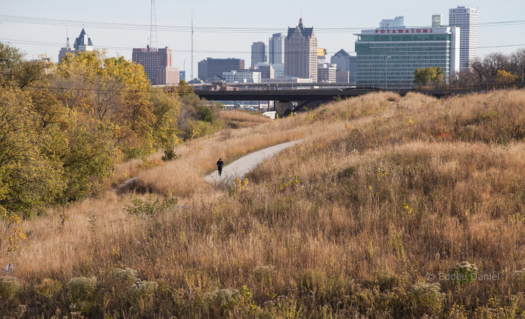 The Hank Aaron State Trail in Three Bridges Park with Milwaukee skyline