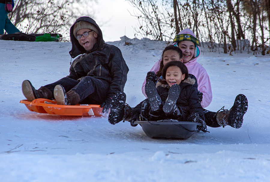 kids sledding with excitement