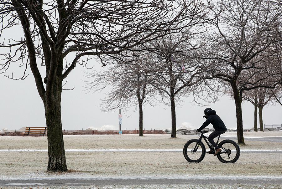 fat tire cyclist on Milwaukee lakefront in icy conditions