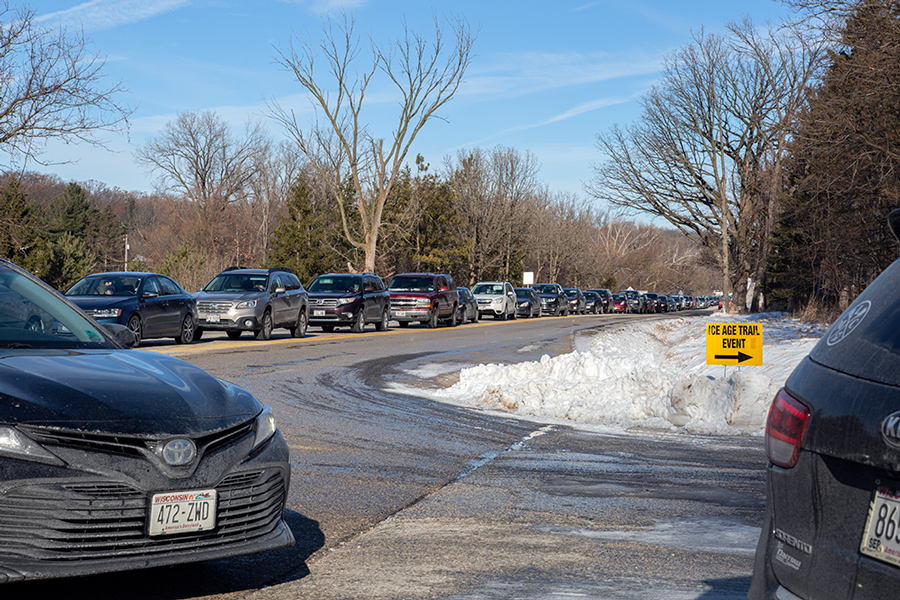 A line of cars waiting at the entrance to Lapham Peak.