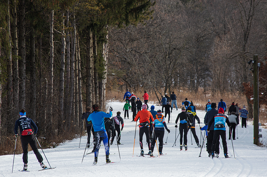 A batch of skiers heading out on the cross country trail