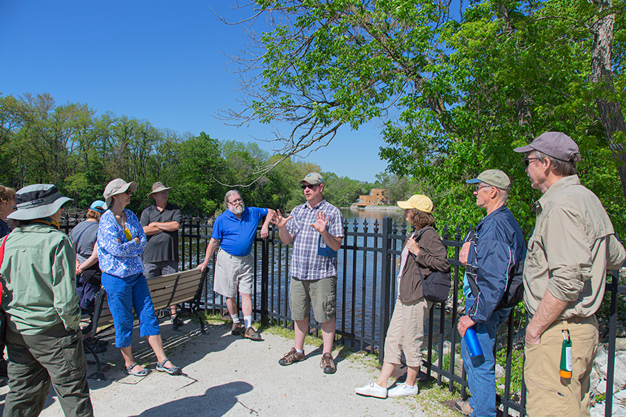 Tour group at Thiensville dam overlook at the Milwaukee River