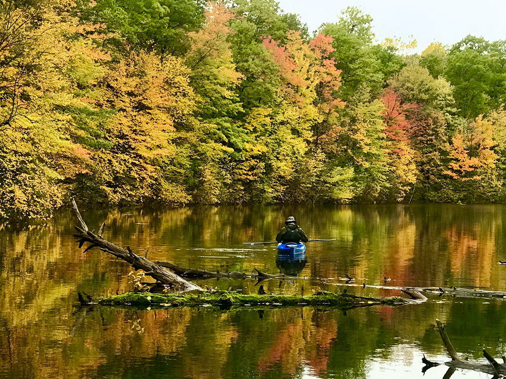 canoe on lake in autumn