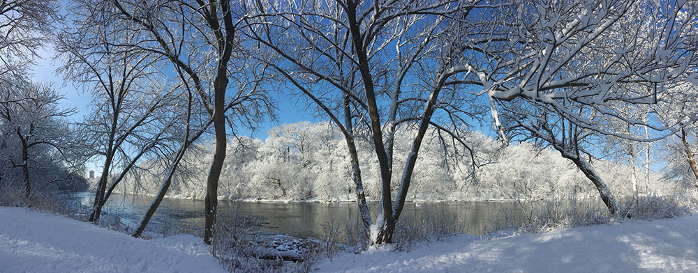 Winter view of snow-covered Milwaukee River banks at Hubbard Park