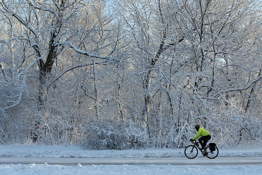 Cyclist in snowy Estabrook Park