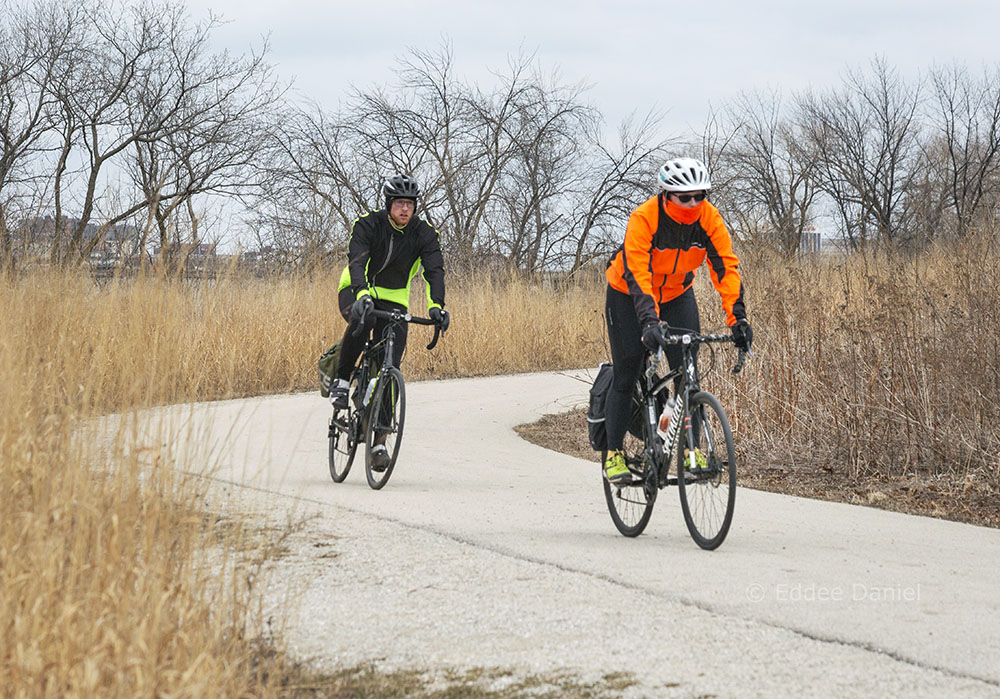 Two cyclists on Hank Aaron State Trail in Three Bridges Park