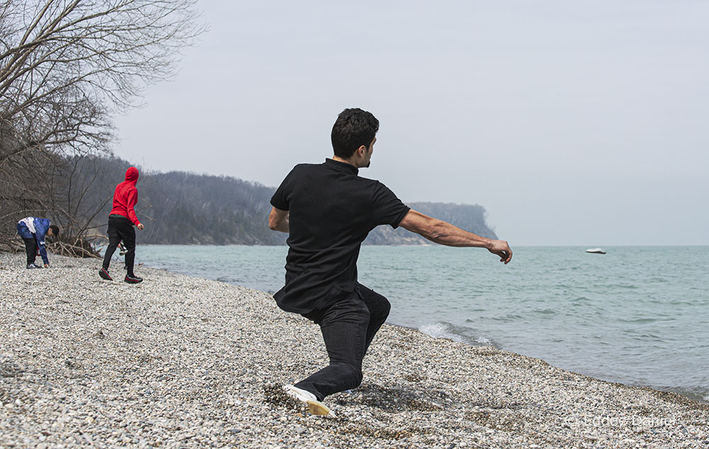 A young man skipping a stone on Lake Michigan at Grant Park, South Milwaukee