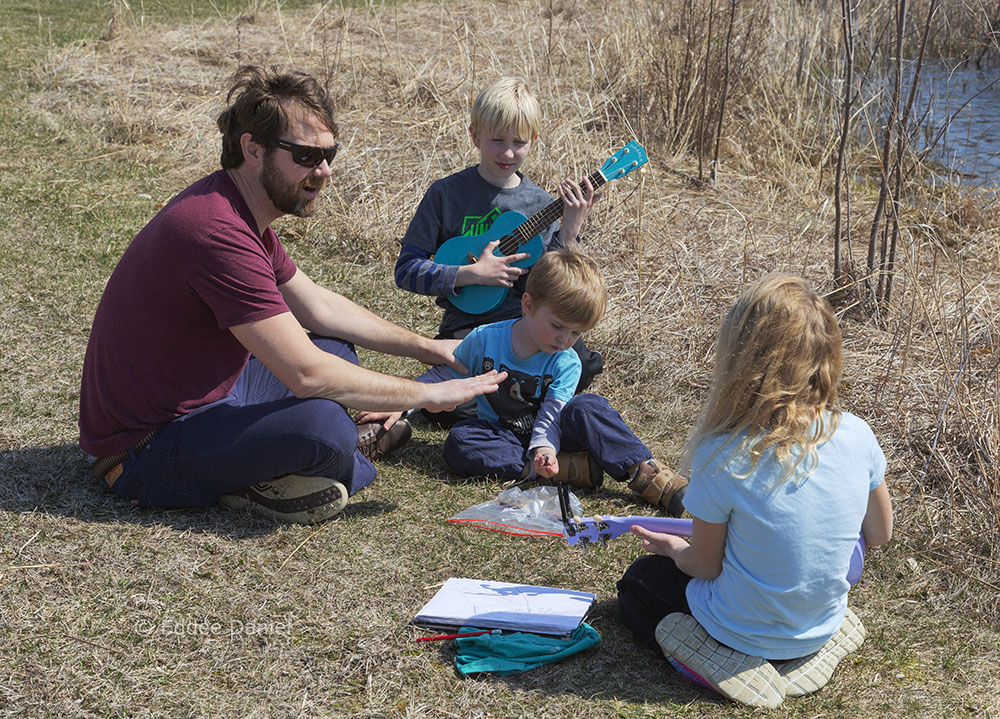 A family making music together at Tendick Nature Park, Saukville.