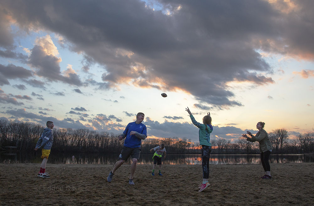 The Nellis family playing beach football at sunset, Fox Brook Park, Brookfield.