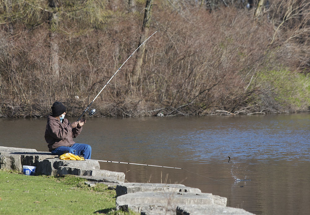 Fishing with a face mask. Jackson Park, Milwaukee