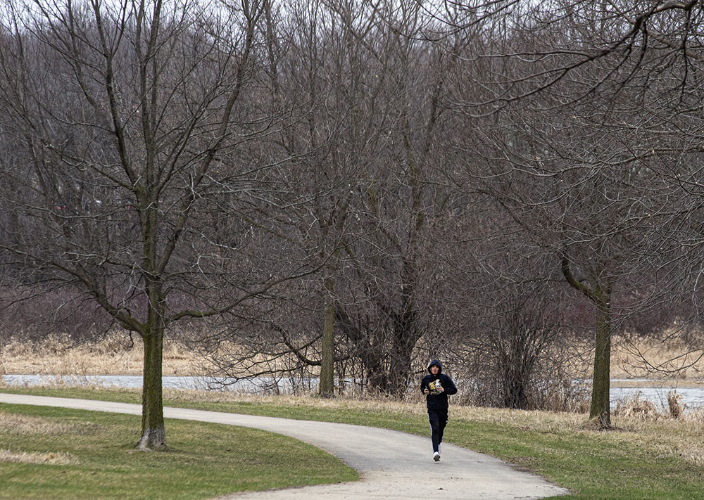 A lone jogger sprints along the Fox River Parkway in Waukesha.