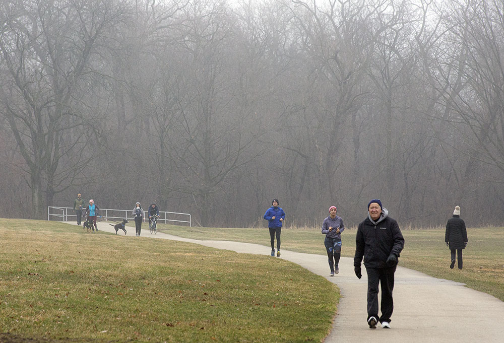 Social distancing is the rule on the Oak Leaf Trail in ever-popular Hoyt Park, Wauwatosa, even in foggy, drizzly conditions!
