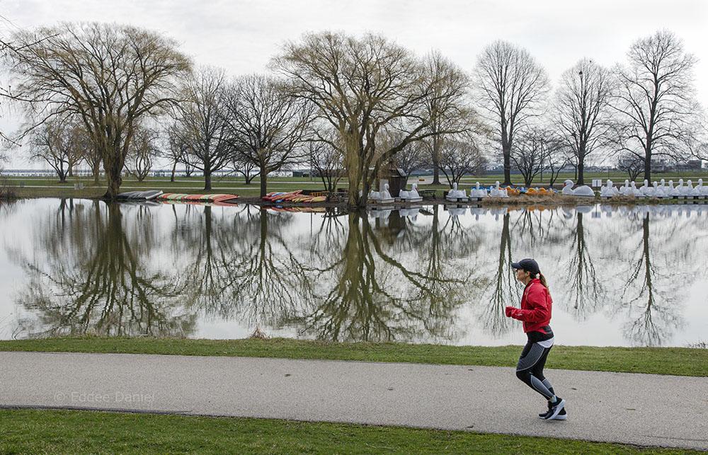 Jogger and lagoon at Veterans Park, Milwaukee, WI.
