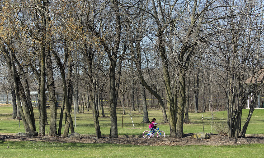 This little girl was just learning to ride with help from grandfather, Malone Park, New Berlin.