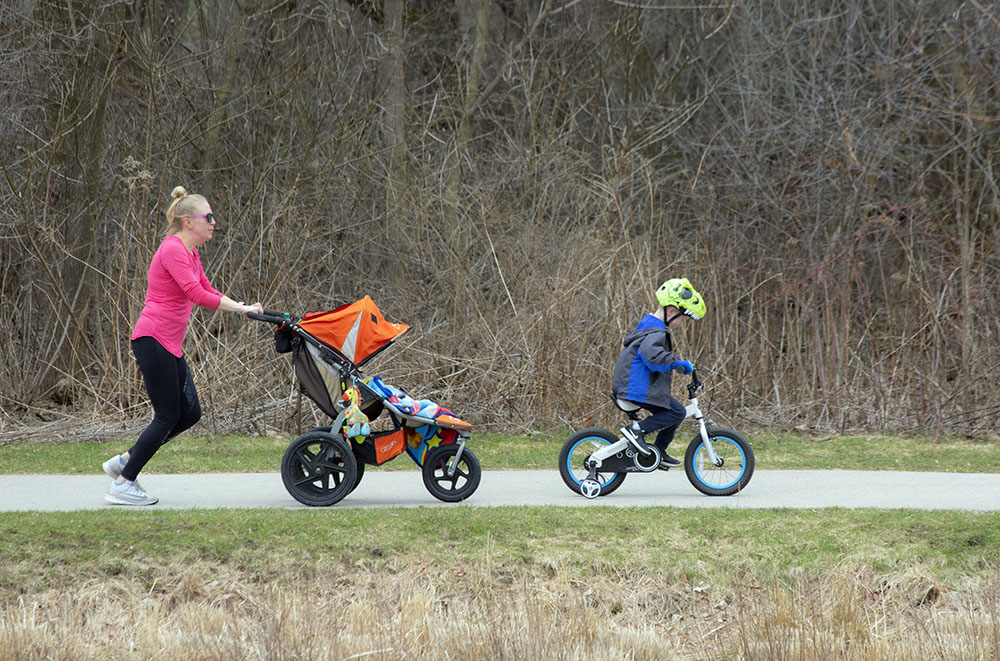 A family trio on the Menomonee River Parkway in Wauwatosa