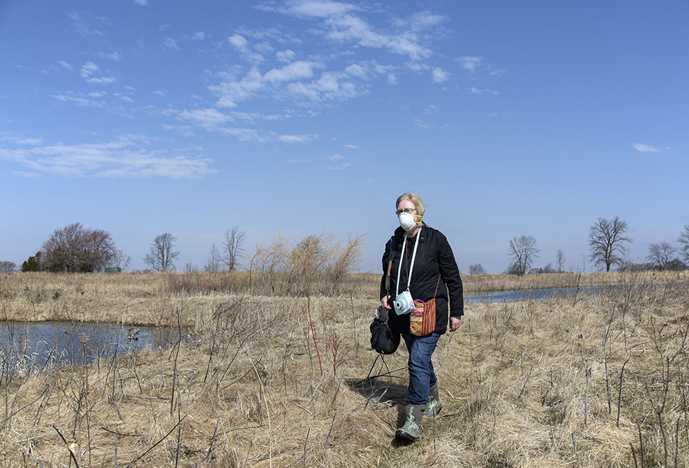 A hiker wears a precautionary mask at Forest Beach Migratory Preserve, Ozaukee County.