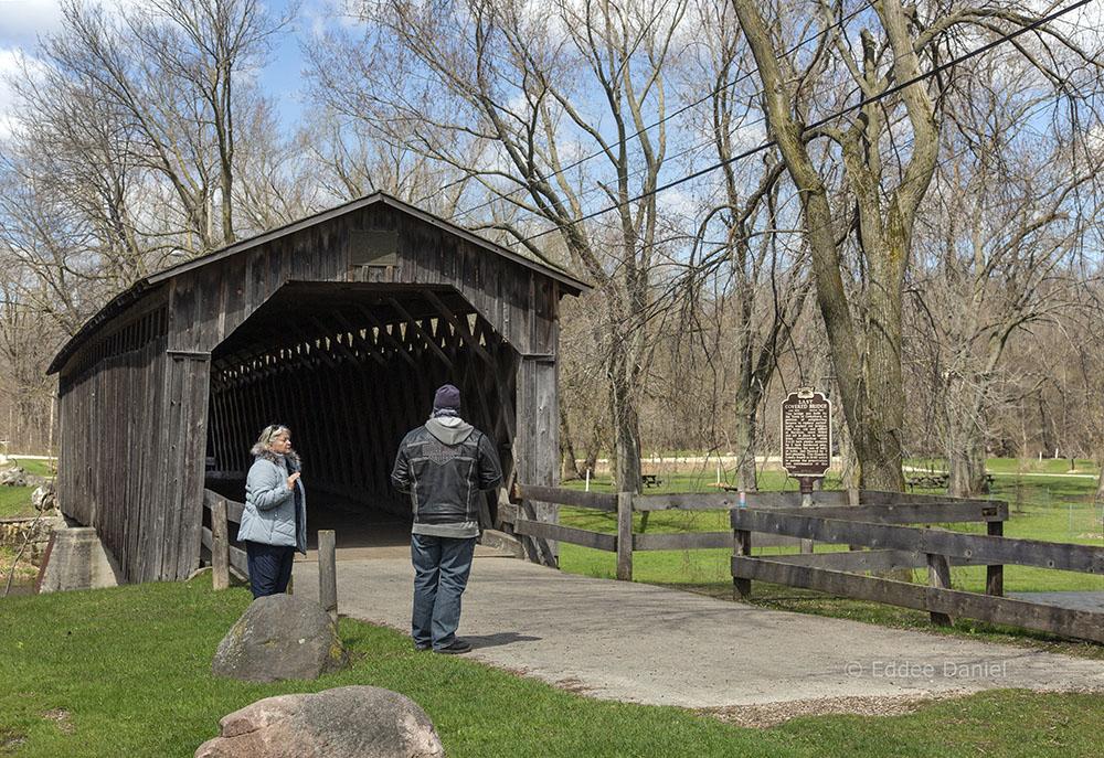 Social distancing of strangers at historic bridge. Covered Bridge Park, Cedarburg