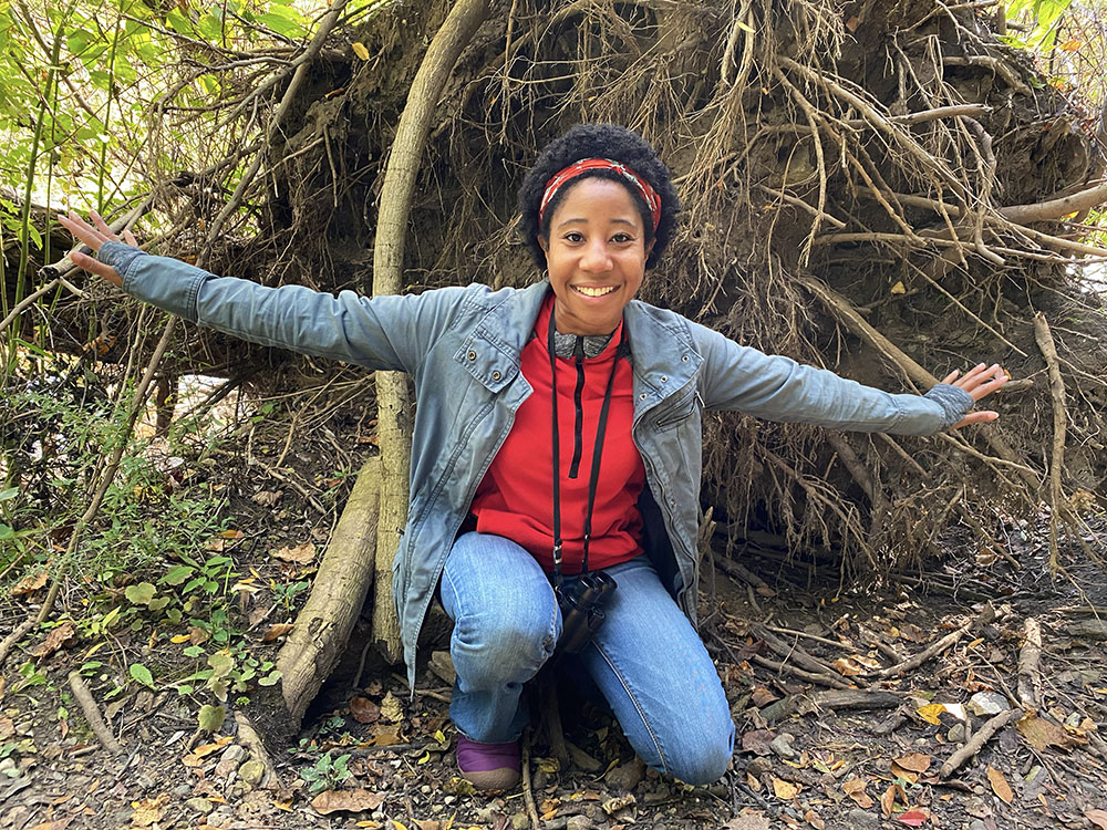 The author, grateful, in front of an upended root ball.