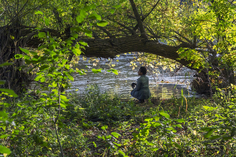 The author exploring the riverbank