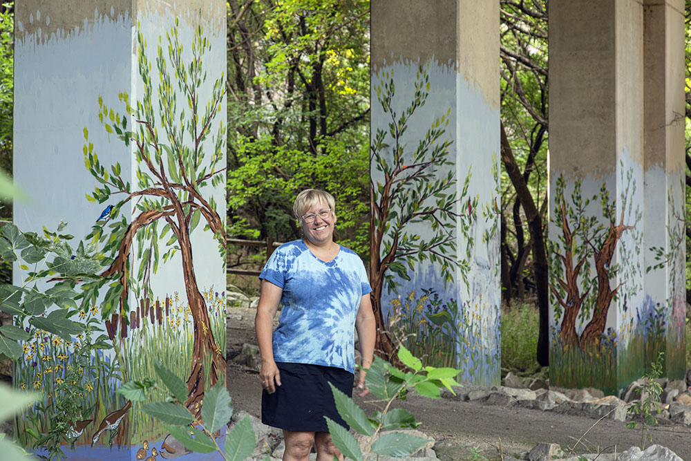 Another long-time friend, artist Melanie Ariens, with her murals under the North Avenue bridge.
