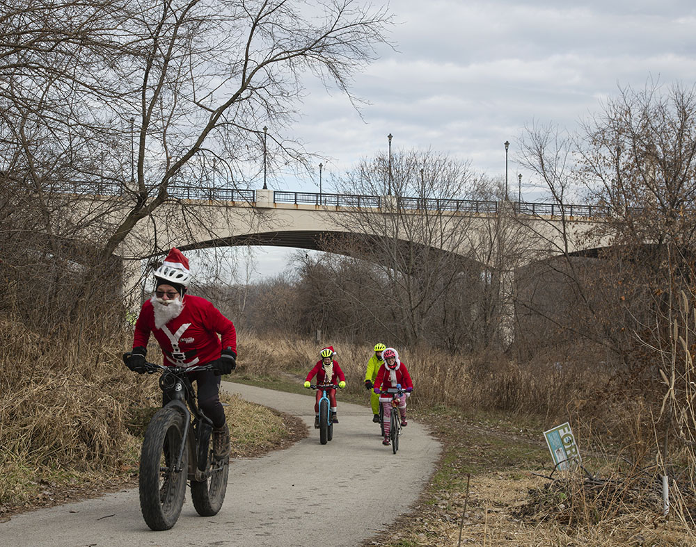 Cyclists on the Beerline Trail head for Santa Rampage 2019