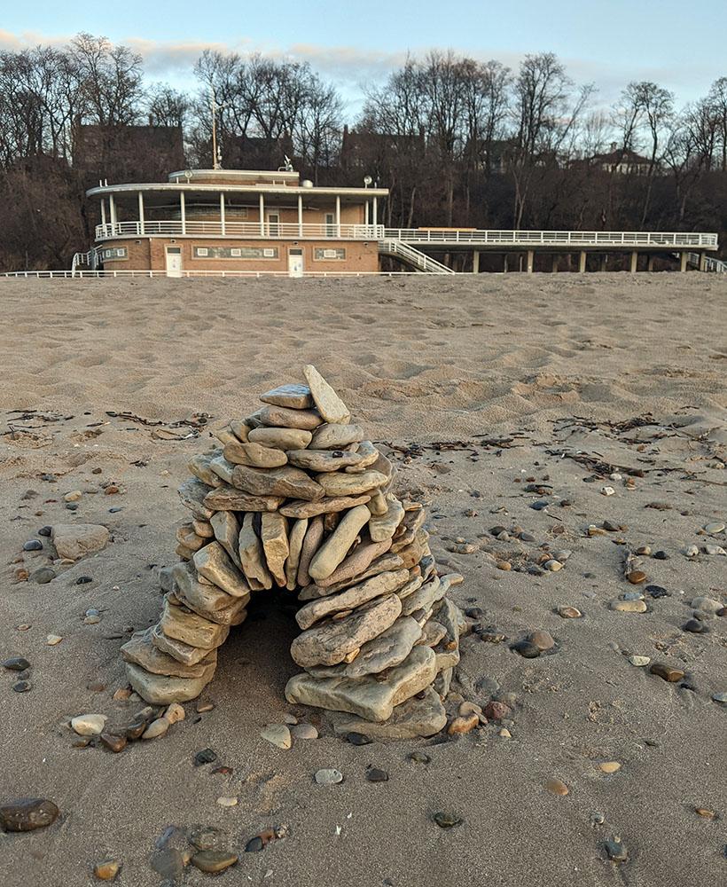 A rock cairn left on the beach.