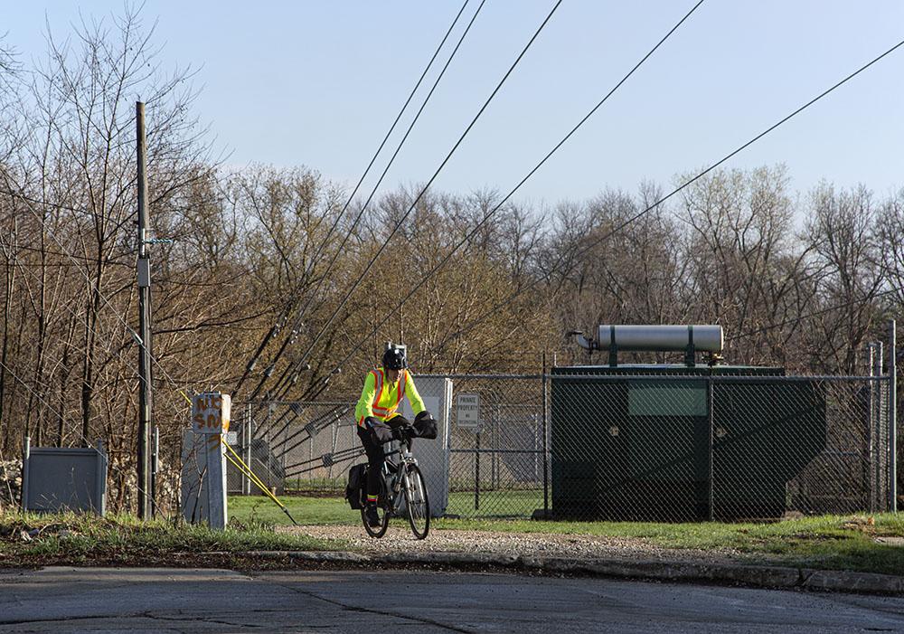 A cyclist behind the Blue Hole and the solar array.