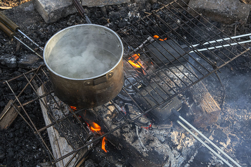 Sap boiling and pancakes frying on the campfire.